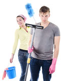 Spring cleaning. Wife wants to clean the house with grumpy men holding vacuum cleaner Royalty Free Stock Photos