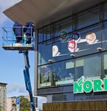 Spring cleaning of windows. VILNIUS, LITHUANIA - MAY 17, 2016: Spring cleaning of windows in shopping center Helos City on Savanoriu Street (street of a name of Royalty Free Stock Image