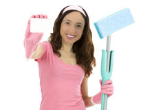 Spring cleaning woman showing blank sign card. Cleaning woman holding cleaning tool and showing sign card Stock Image