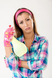 Spring Cleaning Woman. Is tired and lazy of cleaning. She is wearing pink rubber gloves and looking at camera Royalty Free Stock Image