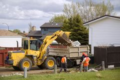 Spring Cleanup. City workers cleaning up residential refuse Stock Photos