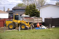 Spring Cleanup. City workers cleaning up residential refuse Royalty Free Stock Photos