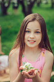 Spring closeup outdoor portrait of adorable 11 years old preteen kid girl. Spending spring holidays in beautiful blooming cherry garden Stock Images