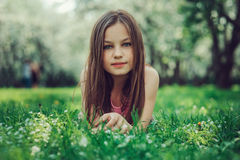 Spring closeup outdoor portrait of adorable 11 years old preteen kid girl. Spending spring holidays in beautiful blooming cherry garden Stock Photos