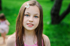 Spring closeup outdoor portrait of adorable 11 years old preteen kid girl Stock Images