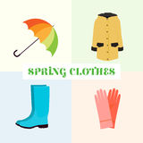Spring clothes. Umbrella, boots, raincoat. Spring woman`s clothes. Color, realistic, vector Stock Image
