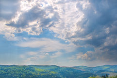 Spring cloudy sky in mountains. Spring cloudy sky in the mountains royalty free stock images
