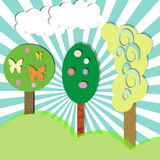 Spring. Colored background with trees and clouds and green lawn Stock Photo