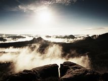 Spring colorful mist between summits. Cliff above forest Royalty Free Stock Photos