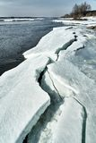 Spring comes in Siberia. Ice crushes on the river, trees stands without leaves stock photo