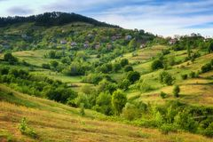 Spring is coming... Amazing spring view with a little village in Rhodopi Mountains, Bulgaria. stock photo