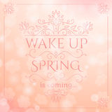 Spring is coming lettering on blurry lights Royalty Free Stock Image