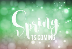 Spring is Coming - welcome sign. Vector typography in fresh colors for your design. Vintage lettering on blurred bokeh green Stock Photo