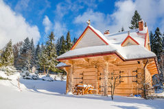 Spring comming to closed mountain hut in winter Royalty Free Stock Photo