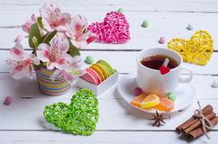 Spring composition: a cup of tea, almond cookies, bright flowers Stock Image