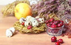 Spring composition, nest with eggs near the bunch of heather, Easter. stock photo