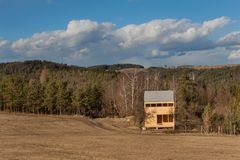 Spring on the construction of ecological buildings. Unfinished wooden house on the edge of the forest. Spring weather in the Czech Royalty Free Stock Photos