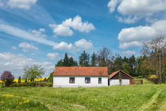 Spring countryside with beautiful old country house Stock Image