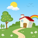 Spring Countryside Landscape. A spring day countryside landscape with a friendly house, flowers, trees, rainbow, sun and clouds. Useful also for educational and Stock Photo