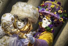 Spring couple of in Venice carnival masks Royalty Free Stock Photo