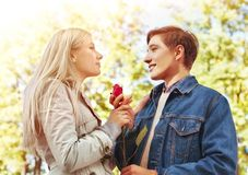 Spring couple walking and kissing summer park. Stock Photos