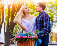 Spring couple walking park. Summer friends walk outdoor. Royalty Free Stock Photos