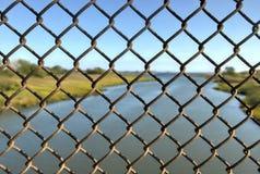 Spring Creek, View through Fence Stock Photos