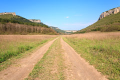 Spring Crimean mountain landscape with road Stock Photo