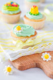 Spring cupcakes with flowers Stock Photography
