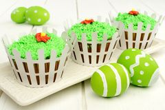 Spring cupcakes with white picket fence Stock Image