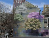 `Spring` by David Guinn, Philadelphia, Pennsylvania. Pictured is the mural `Spring` by David Guinn. It was painted in 2000 and restored in 2017. It is a City of royalty free stock photos