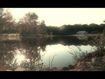 Spring daze. Reflection off of pond royalty free stock image