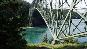 Spring at Deception Pass, Washington State, USA. The beautiful Deception Pass in Washington State, USA. Iron bridge crossing an ocean inlet Stock Image