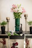 Spring decor, a statuette, flowers in a vase. Royalty Free Stock Photos