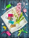 Spring decoration making with  hyacinth flowers,sign and scissors, holiday composing on blue wooden background, Royalty Free Stock Photos