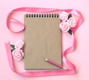 Spring delicate pink paper background with rose flowers royalty free stock photos