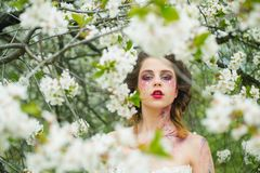 Spring depression. Natural beauty and spa therapy. face and skincare. womens health. allergy to flowers. Woman with. Spring fashion makeup. Springtime. weather royalty free stock photography