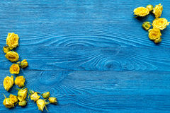 Spring design with roses on wooden desk background top view mockup Royalty Free Stock Photo