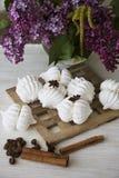 Spring dessert of meringues on beige background Stock Photo