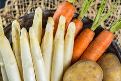 Spring dinner ingredients - fresh white uncooked asparagus, carr royalty free stock photos