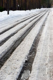 Spring dirty snowy tracks. In Saint-Petersburg countryside Royalty Free Stock Photography