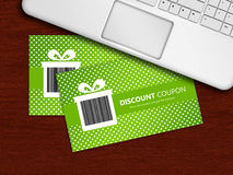 Spring discount coupons with laptop lying on table Stock Photography