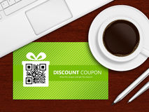 Spring discount coupons with laptop and office tools lying on ta Royalty Free Stock Photography
