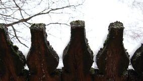 Spring drops under the old roof. Melting icicles in the spring under the roof. Spring melting of ice. Thaw, the off-season, late winter, early spring stock video footage