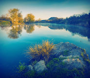 Spring early morning on a lake_vintage Stock Image