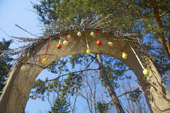 Spring Easter arch, decorated with willow. painted eggs hanging on the ropes,. Spring Easter arch, decorated with willow. painted eggs hanging on a string, on a Stock Images