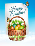 Spring Easter background. Easter eggs in basket with flowers Stock Photo