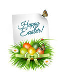 Spring Easter background. Easter eggs in grass with flowers. Vec Stock Images