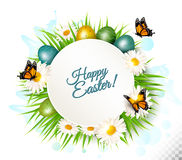 Spring Easter background. Easter eggs in grass with flowers. Vec. Tor Stock Photography