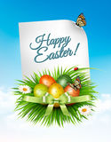 Spring Easter background. Easter eggs in grass with flowers. Royalty Free Stock Image